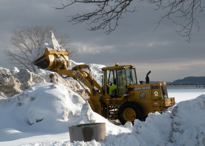 Snow FrontLoader in Memorial Park. Photo Credit: Richard Kavesh