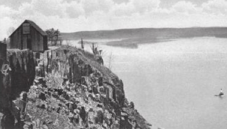 """The rock quarry workman's shed is seen on top of Hook Mountain and the Rockland Lake lighthouse is visible in the Hudson River. The rock formation in this picture is a good example of the Palisades Sill which was formed from the solidified magma during the Triassic period."" Source: Robert C. Maher, author ""Images of America: Rockland Lake, Hook Mountain and Nyack Beach""  Acadia Publishing"