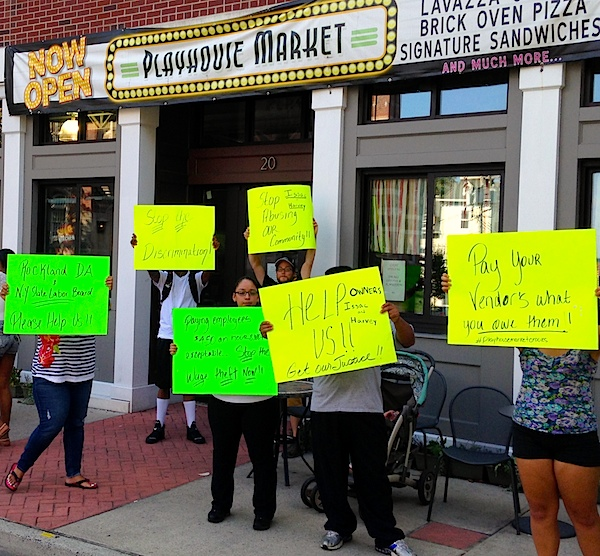 Employees and vendors protest at the Playhouse Market on 8/7/2014