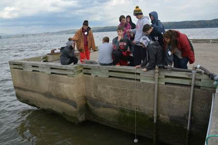 At the end of Piermont Pier students collect water depths throughout the day to see how tidal cycles affect their other measurements.