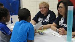 Suez educators Bonnie Horowitz and Robin Kroll talk water sense with Liberty first graders