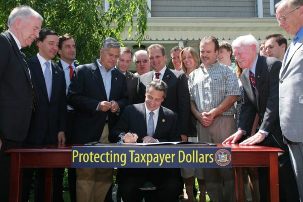 June 30, 2011, Lynbrook - Governor Cuomo signs property tax cap legislation at the home of James and Janet Gannon in Nassau County.